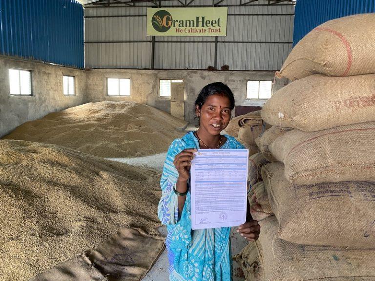 A farmer standing in farming warehouse