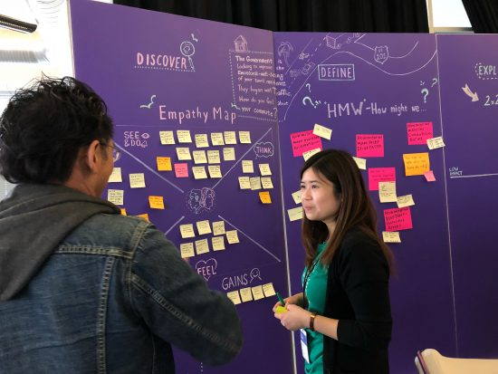 DevNet's Casey Tong discusses API design at the Design Thinking booth at DevNet Create