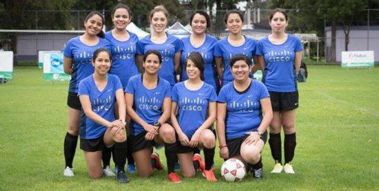 Alejandra and her teammates in Cisco jerseys on a soccer field.