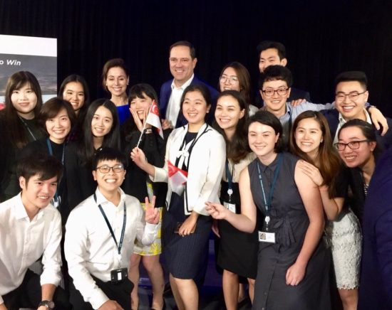 Cisco Interns pose with our CEO Chuck Robbins during an event.