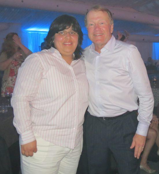 Roxana with former Cisco CEO John Chambers.