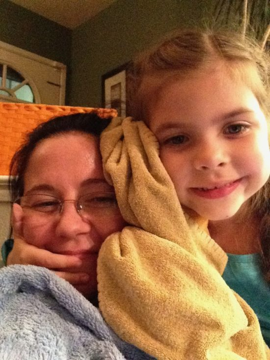 Danielle and her daughter Helene cozy up in blankets.