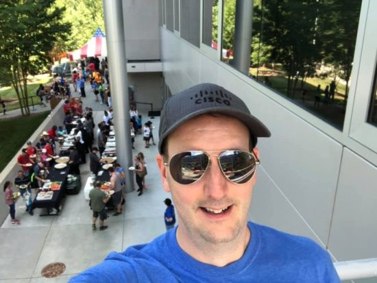 A selfie of Jeff with the annual RTP Family Day frestivities behind him.