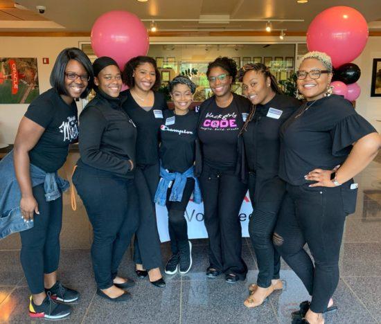 Crystal smiling alongside 6 of her Black Girls Code peers.