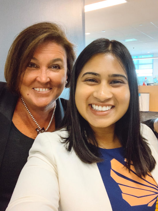 Alisha smiles with Cisco CFO Kelly Kramer