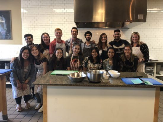 Alisha alongside her team at a cooking class.