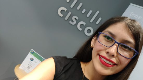 Yartiza poses in front of a Cisco sign.