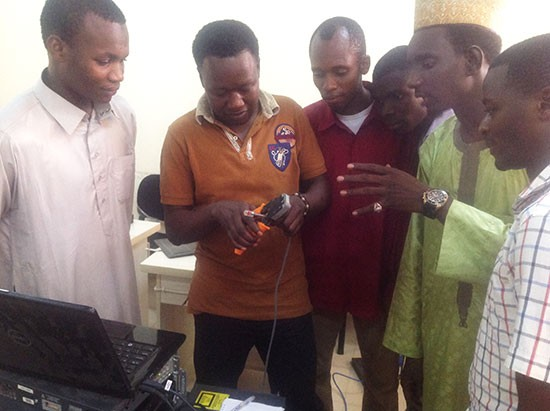 Students in the Cisco CCNA Routing &  Switching course work in  the practical lab at American University of Nigeria.