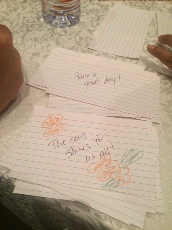 Volunteers wrote cheerful notes to give the homeless in HomeFirst's snack bags