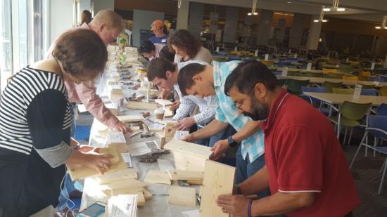 Cisco Volunteers building birdhouses for new home-owners of Habitat Humanity