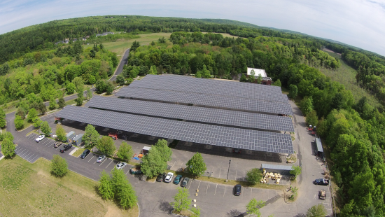 Free standing solar PV array in the parking area of Cisco's campus in Boxborough, MA