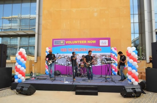 Employee rock band the Lone Rangers perform at a volunteer event for the Akshaya Patra Foundation