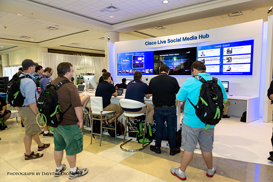 Attendees gather to watch a keynote address at the Social Media Hub.