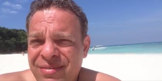 Employee David Faik on the beach in Thailand