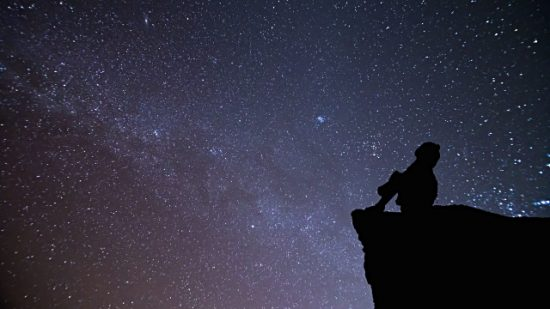Girl staring into the stars
