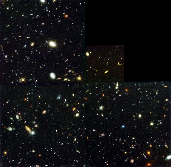 An image from the Hubble Deep Field, which provides a narrow glimpse into of the known universe as it existed billions of years ago. [SOURCE: Wikipedia]