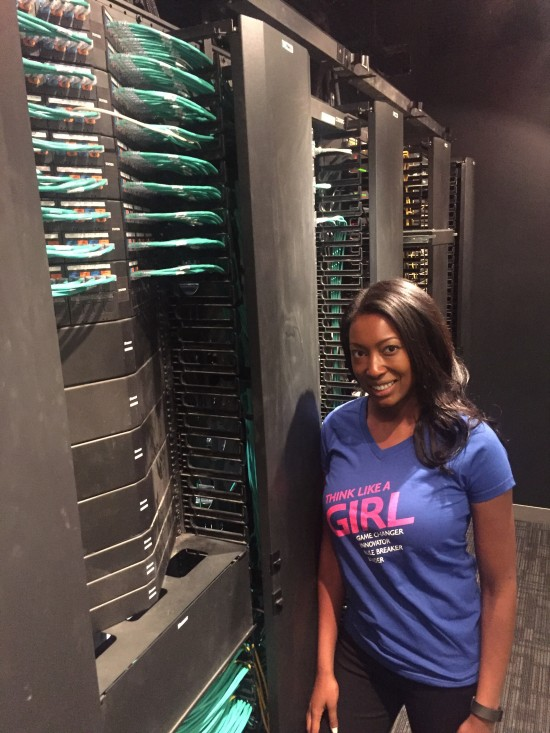 Aisha Bowe, CEO STEMboard and guest speaker for Girls Power Tech, in front of the rack space at the Cisco office.