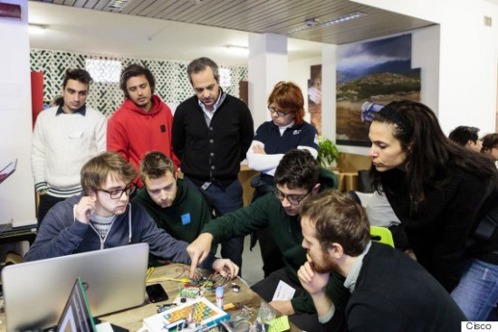 Students in Milan learning the importance of the Internet of Everything during their hands-on lessons in IT.