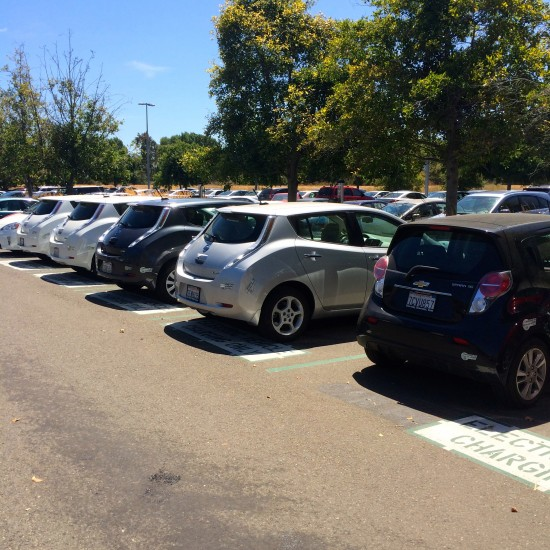 A row of electric cars charges at Chargepoint stations on Cisco's San Jose campus
