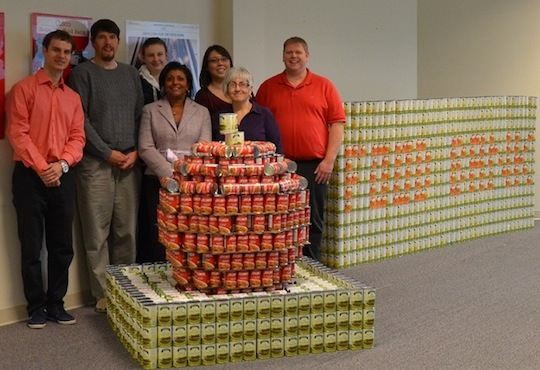 The Kanata R&D team proudly displays their cansculpture of an apple to support their local food bank.