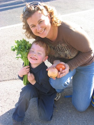 A mother and son pick up food from the Second Harvest Food Bank