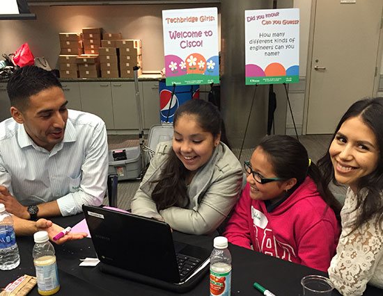 Employee volunteers help students learn about programming on Code.org