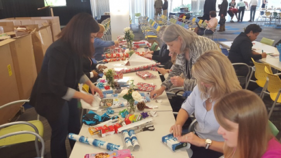 Cisco Volunteers wrapping holiday gifts for families of Interact of Wake County