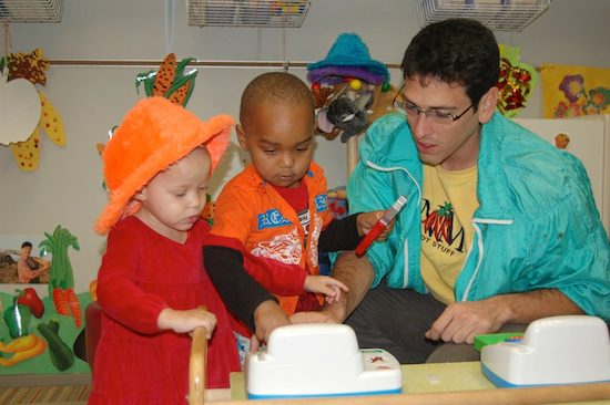 Wesley King volunteering with children at Learning Together, a nonprofit that meets the developmental, educational, and health needs of young children of all abilities.