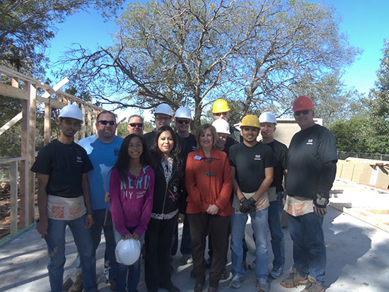 Soon-to-be homeowner Gloria Alamos and her daughter with Beth Kolman and the team of Cisco employee volunteers with Waco Habitat for Humanity.