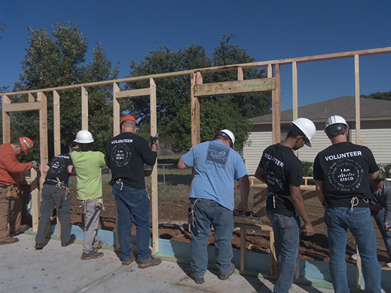 Cisco employee volunteers build walls for the new home of Gloria Alamos, whose previous house was destroyed when a fertilizer plant exploded in West, Texas, on April 17, 2013.