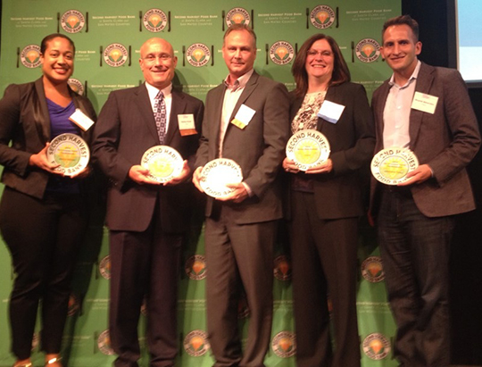 "Cisco received 4 ""Making Hunger History"" awards from the Second Harvest Food Bank on September 10. On hand to receive them were (l-r): Jessica Graham,  community relations manager; Randy Pond, senior vice president of operations; Curt Hill, VP of technical support; Rebecca Jacoby, chief information officer and a Second Harvest board member; and Ricardo Benavidez, senior community relations manager."
