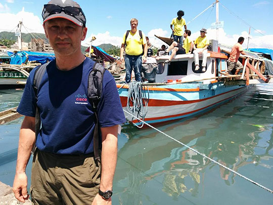 The author and his team leaving Tacloban by boat for the four-hour trip to the remote island community of Daram.