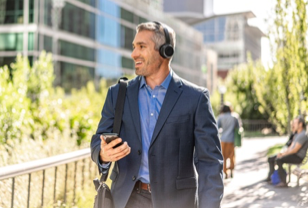 Man walking on sideway wearing new Cisco Headset 700 Series