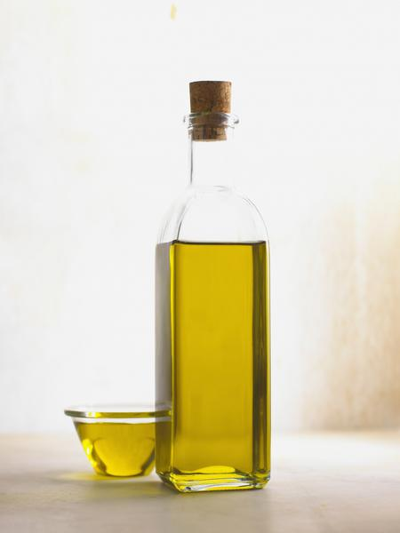 Rapeseed oil in bottle and bowl.