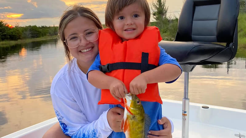 Mom and Son Peacock bass fishing