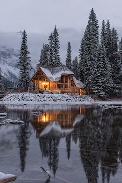 A cabin on a snowly lake