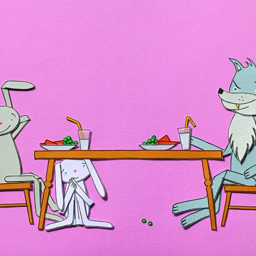 Paper cutouts of rabbits and a wolf sit at a dinner table together