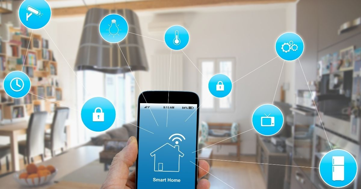 A hand holding a smart phone using smart home technology