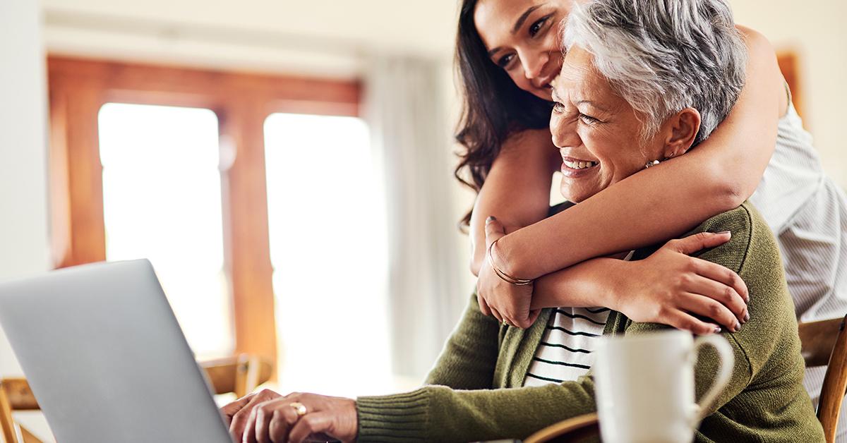Daughter hugging her senior mother