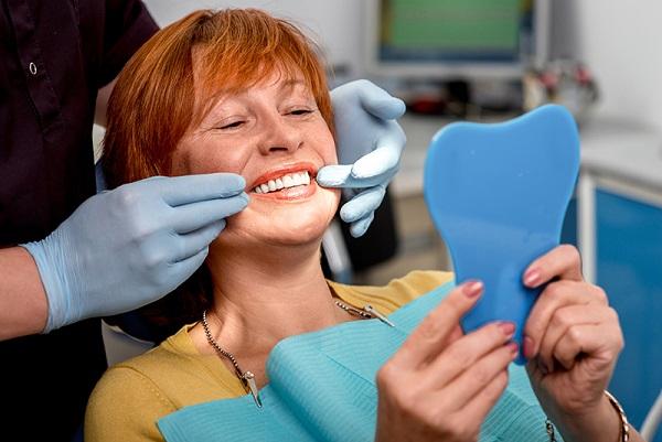 Replacing Missing Teeth: Dentures vs. Dental Implants