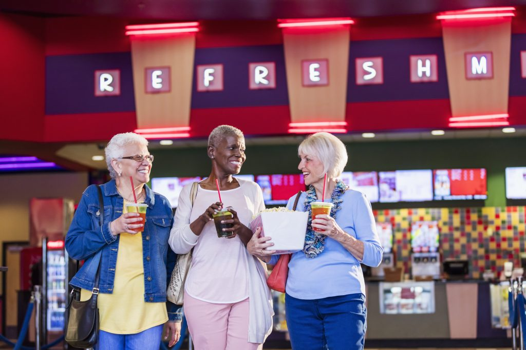 Multi-ethnic senior women at the movies near Broadview Senior Living