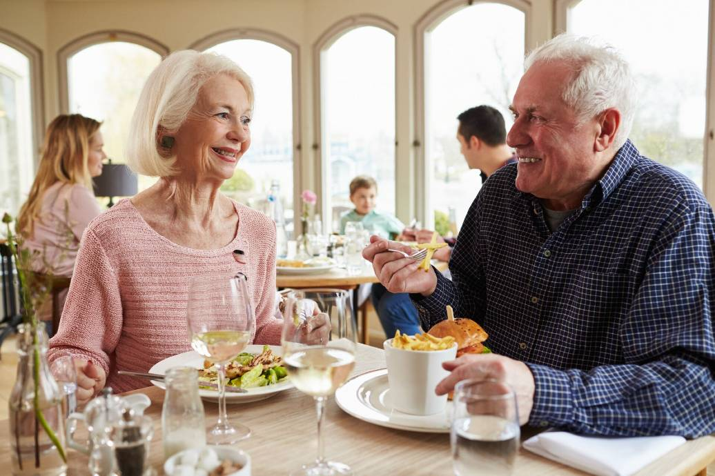 Senior couple eating at a restaurant