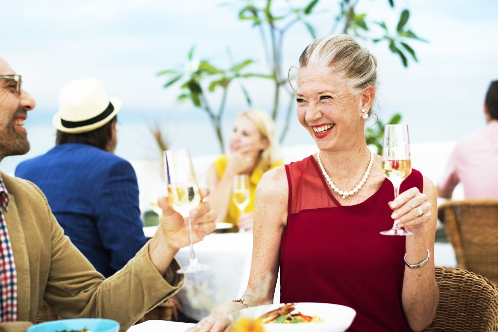 Senior woman enjoying a glass of wine outdoors