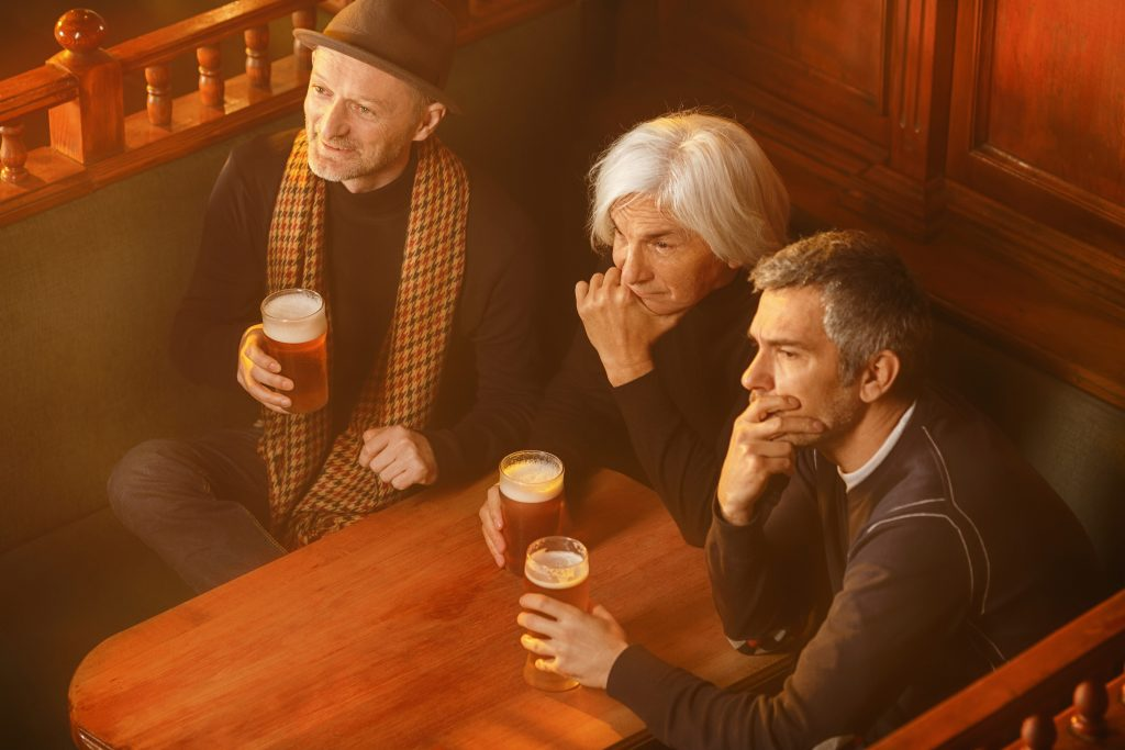 Seniors at a pub watching a game