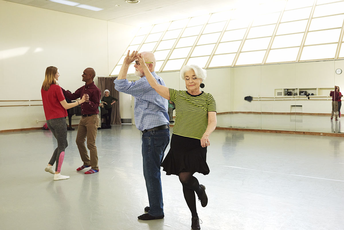 Senior couple taking a dance class