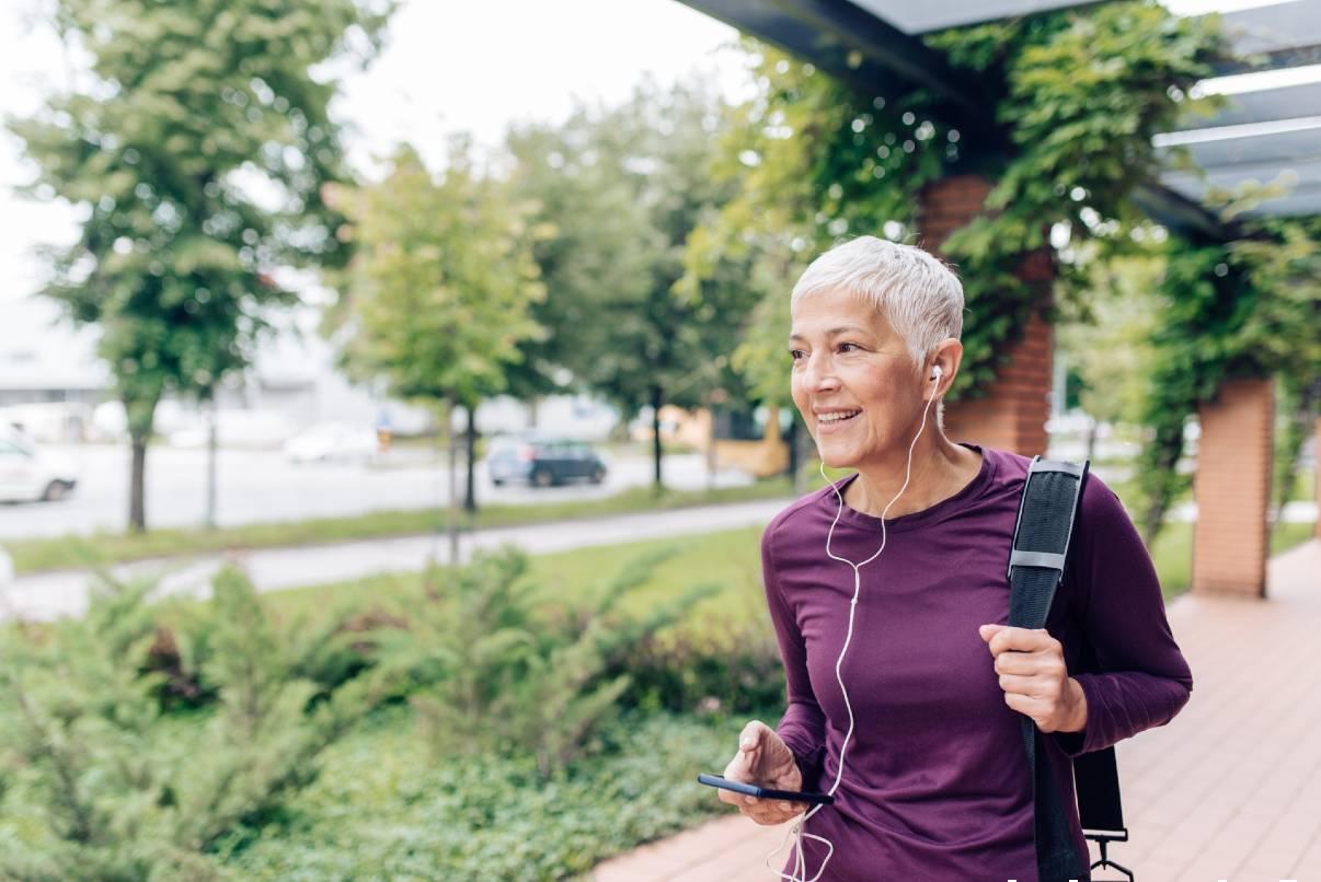 Senior woman listening to favorite podcast