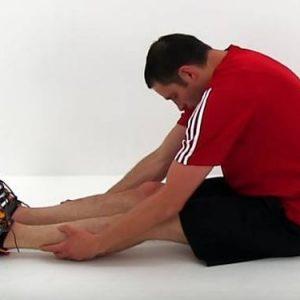Assouplissement du dos #1 - toucher des pieds assis