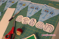 Simple Baby Bunting - Outline the letters in a heavy marker like Sharpie.