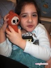 Big Sis with Orange Crochet Baby