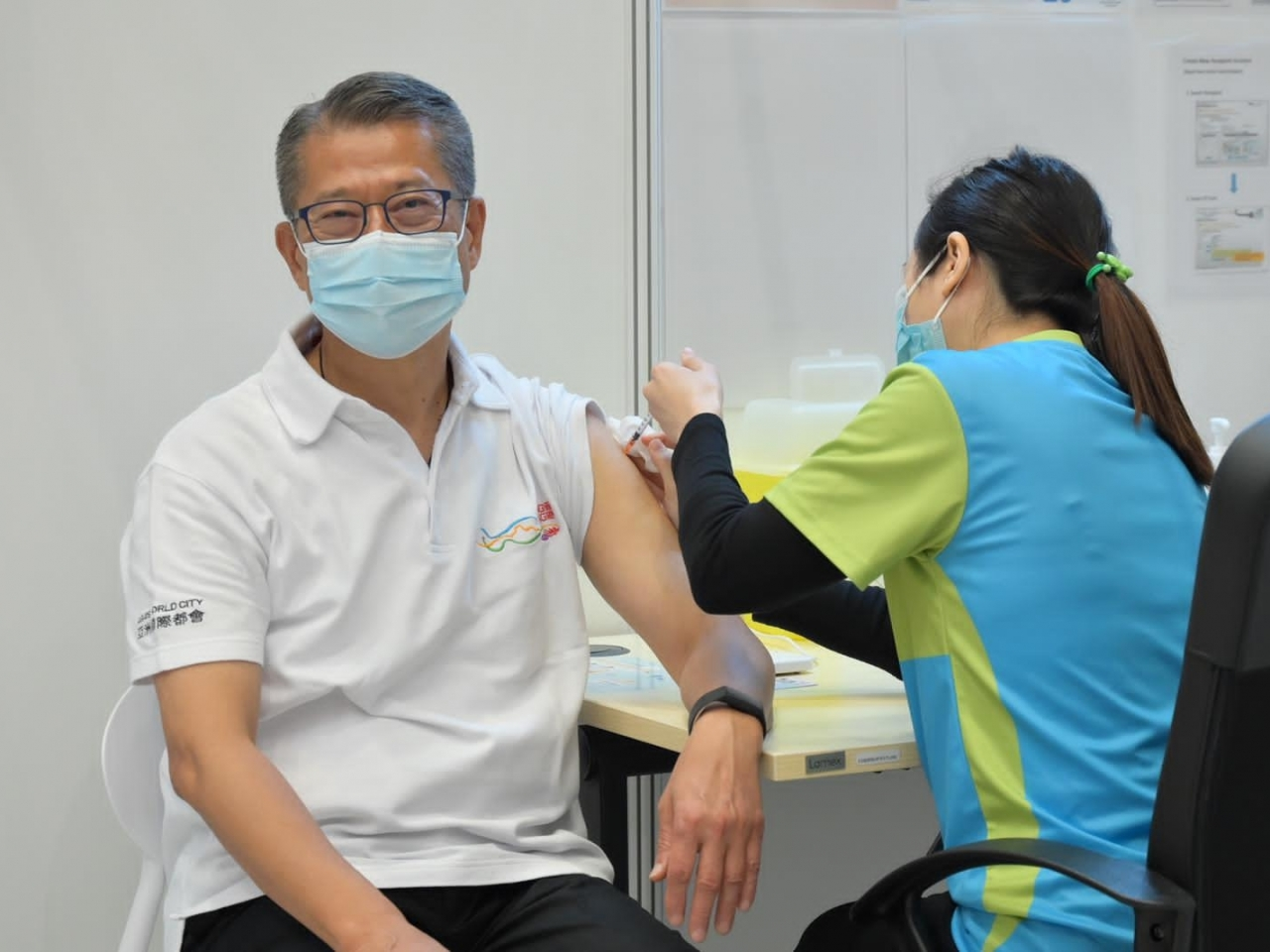 Low vaccination rate may harm economy: Paul Chan